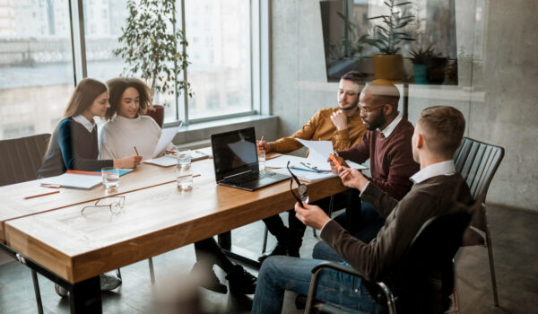 front-view-people-having-meeting-office
